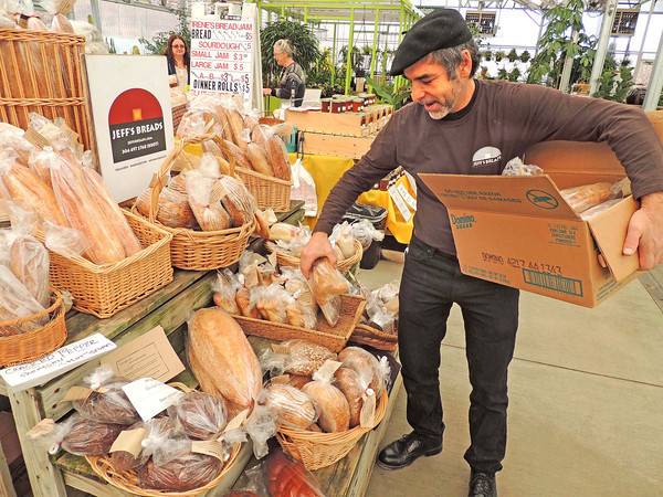 Jeff Kessler, of Jeff's Breads in Lewisburg, restocked his piles of freshly baked product at Friday's Farm to Table Market at Greenbrier Nurseries.<br /> Brandi Underwood/The Register-Herald
