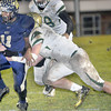 Malik Boatwright of Greenbrier West, left, breaks the tackle of Notre Dame's Jordan Miller, right, during State class A playoff action in Charmco. F. Brian Ferguson/The Register-Herald