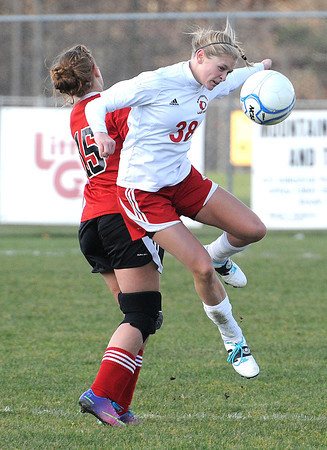 Maranda Keaton, left, of Pikeview, defends against, Jennafer Alonge, of Bridgeport in the class AA-A girls soccer semi-final match held at the YMCA Youth Sports Complex in Beckley Friday morning.<br /> Rick Barbero/The Register-Herald