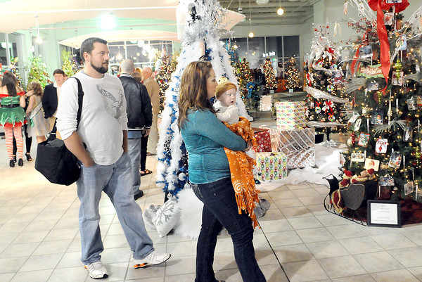 The Lewis Automotive Pre-owned showroom was a full house on Friday evening for the United Way Wonderland of Trees auction. F. Brian Ferguson/The Register-Herald