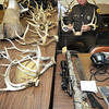 F.C. Basile, police officer Division of Natural Resources, holds one of the 16 antlers he confiscated in Greenbrier and Monroe counties.<br /> Rick Barbero/The Register-Herald