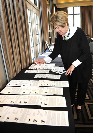 Susan Landis looks over pledge cards during the Spirit of Beckley Kick-Off Breakfast held Tuesday morning in the ball room at Black Knight Country Club.<br /> Rick Barbero/The Register-Herald