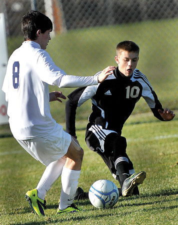 East Fairmont's Colin Harvath, left, battles with Pikeview's Paydon Cutlip during the AA/A Boys Stae Soccer Championship game on Saturday in Beckley. F. Brian Ferguson/The Register-Herald