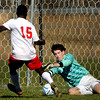 Parkersburg's Immanuel Opku-Duah, left, attempts a goal as George Washington Keeper, Elishia Davis, right, makes the stop during the AAA Boys state Soccer Championship game on Saturday in Beckley. F. Brian Ferguson/The Register-Herald
