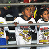 Oak Hill Red Devils fans from left, Antwan Hicks, Armonyi Hicks and Noah Goodman, react after a Red Devil touchdown against Woodrow Wilson Flying Eagles at Oak Hill High School Friday Night.<br /> Rick Barbero/The Register-Herald