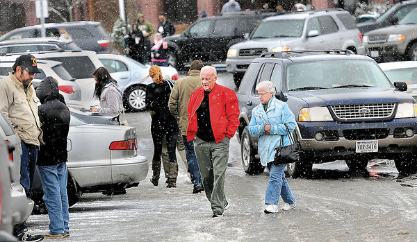 Holiday travelers had to negotiate Wednesday morning's mix of cold, snow, and slush at the I-64, I-77 Beckley Travel Plaza. F. Brian Ferguson/The Register-Herald