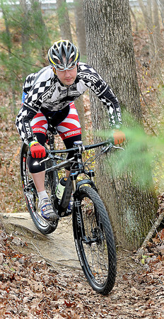 Pro cyclist Clinton Pinkert, of Daniels, takes advantage of a mild Thursday afternoon as he tackles the trails near the YMCA Soccer Complex.. F. Brian Ferguson/The Register-Herald