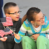 Eli, 4, left, and Raeleigh Wilder, 6, children of Jon and Casie Wilder, of Beckley, watch the Beckley Veterans Day Parade on Neville Street uptown Beckley.<br /> Rick Barbero/The Register-Herald