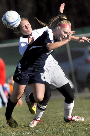 Winfield Kaylee Cross, left, and Washington's Atley Fortnry, right, collide during the AAA Girls State Championship Soccer game on Saturday in Beckley. F. Brian Ferguson/The Register-Herald