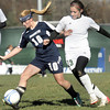 Washington's Katelyn Silveous, left, and  Winfield's Micha Thompson, right, battle for the ball during the AAA Girls State Championship Soccer game on Saturday in Beckley. F. Brian Ferguson/The Register-Herald