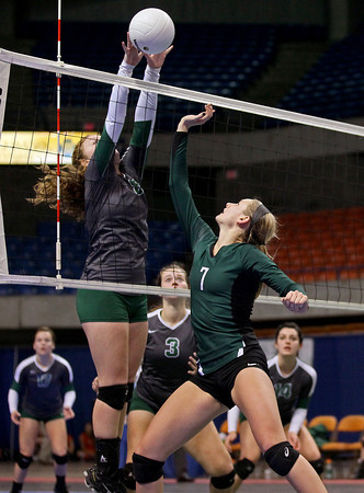 Greenbrier East's Abby Brown's (#7) kill attempt is blocked by Musselman's Autumn Bartles (#8) during the Spartans' Class AAA championship loss to the Applemen Saturday morning in Charleston.