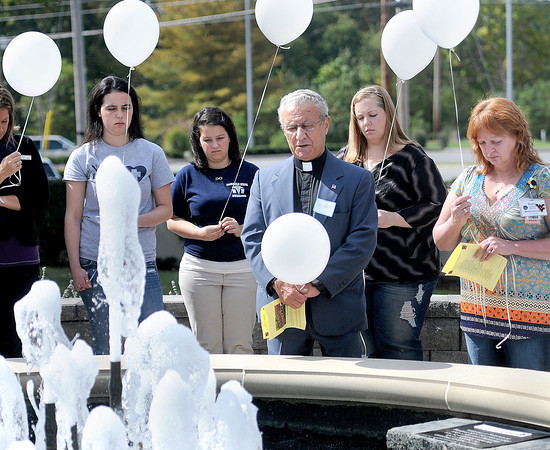 Rev.Adeeb Khalil says a prayer before the balloon release during Saturday's Walk To Remember event at Raleigh General Hospital. F. Brian Ferguson/The Register-Herald