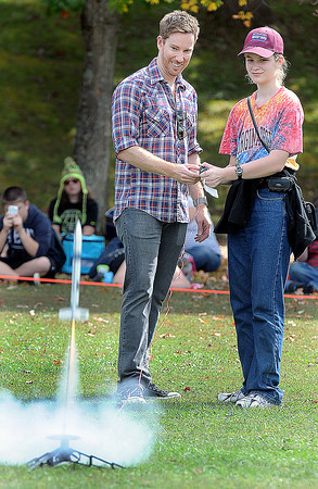 Rocket Boy actor Chris Owen, left, fires the rocket of Virginia Tech student, Renee Spangler, right, during Saturdays Rocket Boy Festival at the Beckley Exhibition Coal Mine.. F. Brian Ferguson/The Register-Herald