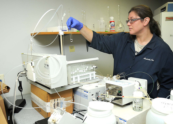 Laurie Mauller, analyst for Analabs Inc., testing sulfates.<br /> Rick Barbero/The Register-Herald