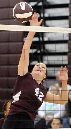 The Woodrow Wilson's Rosalynn Andrade spikes the ball against Oak Hill during Thursday evening action in Beckley.  F. Brian Ferguson/The Register-Herald