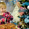 Laciey Lewis, 3, of Mt. Hope, marvels at the Christmas trees at the United Way Wonderland of Trees on Thursday evening at Lewis Automotive pre-owned superstore on Appalachian Drive. F. Brian Ferguson/The Register-Herald