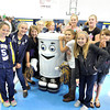 Shady Spring Elementary Green Team fifth graders pose with Kirby the Recycling Robot at Thursday's award assembly. From left: Kaitlyn Sizemore, Ashley Farruggia, Stephanie Garringer, Abigayle Donelow, Allie Minor, Sylvia Workman, Hannah Moretto, Delaney Trump, Briana Lowry and Chloe Mccord. <br /> Brandi Underwood/The Register-Herald
