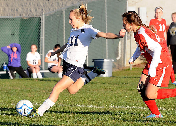 Lyndsey Thompson, of Shady Spring, scores a goal against Oak Hill Monday night at the YMCA Paul Cline Memorial Youth Sports Complex in Beckley and broke a State record for the most goals scored .<br /> Rick Barbero/The Register-Herald