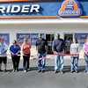 J.D. Byrider had it's official ribbon cutting on Saturday morning, (from left), Rebecca Hanby, Evert Pack, Kathy Greives, Lisa Tipton, Charles Rashid, John Bolds, Paula Pack, Juanita Barrett, and Christopher Price.  F. Brian Ferguson/The Register-Herald