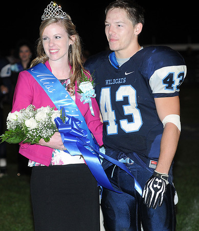 Meadow Bridge 2013 Homecoming Queen Caitlin White, left, and King Jake Parker, right, accept their honors during the half of the Meadow Bridge game against Mt. View on Friday in Meadow Bridge. F. Brian Ferguson/The Register-Herald
