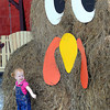 Kinsley Korn, 17 months, daughter of Eric and Leigh Korn, of Crab Orchard, stands in front of, Troyer the Turkey, a display at the Amish Barn Country Store & Deli in MacAthur. The store is having a weekly contest, Take a picture with Troyer, email it to amishbarn@yahoo.com, they will post it to facebook and pick a winner each week until Thanksgiving to win 2 free lunches! (Only one picture per week per person is requested)<br /> Rick Barbero/The Register-Herald