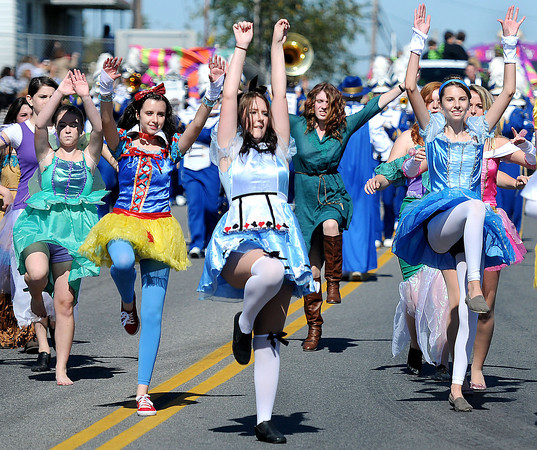 The Shady Spring High School Majorettes took on an international look and dance during Friday's Homecoming parade in Shady Spring. F. Brian Ferguson/The Register-Herald