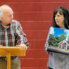 Architect Dan Snead, left, talks about the chapel that he designed for Burlington Family Service as Burlington's Sheila Walker, right, holds a photo of the design during Thursday's press conference to announce the Chris Cline Foundation's donation of $250,000 towards the building of the new chapel. F. Brian Ferguson/The Register-Herald