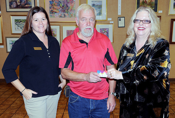 BNI's Tiffani Cornett, left, Job Fair Walmart Gift Card Winner Patrick McLaughlin, of Beaver, center, and BNI's Ann Kelly. F. Brian Ferguson/The Register-Herald