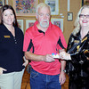 BNI's Tiffani Cornett, left, Job Fair Walmart Gift Card Winner Patrick McLaughlin, of Beaver, center, and BNI's Ann Kelly. F. Brian Ferguson/The Register-Herald