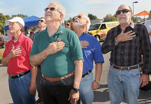 The 4 Rocket Boys, McDowell County's version of the Beatles, paid their respects to the Red, White, and Blue during Saturdays Rocket Boy Festival at the Beckley Exhibition Coal Mine.. F. Brian Ferguson/The Register-Herald