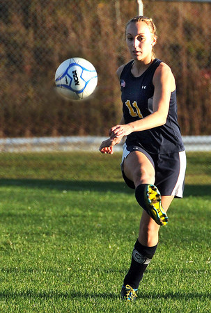 Lyndsey Thompson, 11, of Shady Spring, tries to make a goal against Woodrow Wilson.<br /> Rick Barbero/The Register-Herald