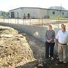 Kelli Harrison, vice president, and Charles Thompson, president, Analabs Inc., stand near the expansion getting built to their building in MacAthur.<br /> Rick Barbero/The Register-Herald