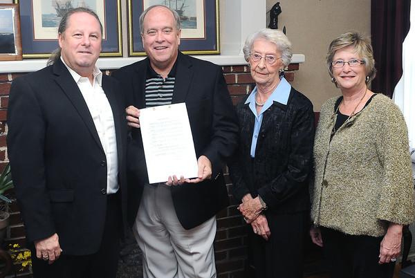 Mayor Emmett Pugh signed a proclamation for the Beckley Concert Association that designated October for recognition of Beckley Concerts 75th Anniversary, (from left), John Yurick, Mayor Pugh, Margaret Sayre, Peggy Debnam. F. Brian Ferguson/The Register-Herald