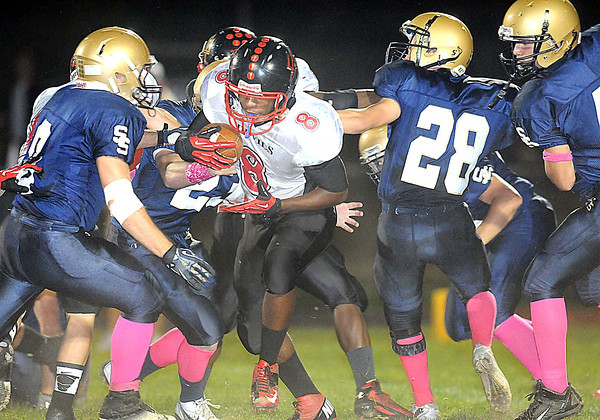 Antonio Smith, of Oak Hill, breaks away for some yardage against Shady Spring defenders Friday night on H.B. Thomas Field at Shady Spring High School<br /> Rick Barbero/The Register-Herald