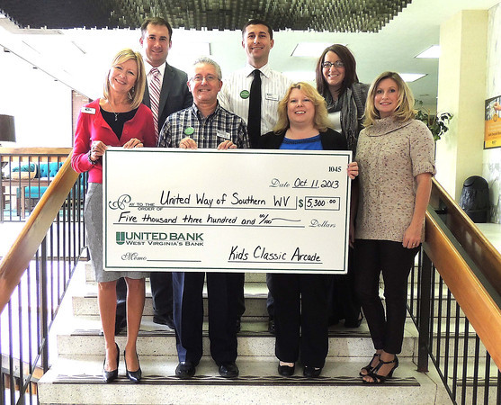 Staff members of United Bank on Main Street presented the proceeds from the 20th annual Kids Classic Arcade on to Margaret O'Neal, executive director of the United Way Southern West Virginia, on Friday. From left: Margaret O'Neal, DF Mock, United Way market president, Greg Lilly, sales and service representative, Matthew Durnan, sales and service representative, Melanie Leach, branch manager, Ashley Mahaffey, lending assistant, and Corey Dunbar, commercial loan assistant. United Bank staff members served on this year's Kids Classic Arcade Committee. <br /> Brandi Underwood/Register-Herald