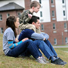 Isaac Conaway gets a front row seat on the shoulders of Michael Belson as wife, Rebekah Belson takes in the Homecoming soccer game at Appalachian Bible School on Friday afternoon. The Belsons are both Seniors at ABC and Isaac is watching his Uncle compete.  F. Brian Ferguson/The Register-Herald