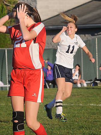 Erin Heeter, of Oak Hill left, reacts after Lyndsey Thompson, of Shady Spring, scores a goal Monday night at the YMCA Paul Cline Memorial Youth Sports Complex in Beckley and broke a State record for the most goals scored .<br /> Rick Barbero/The Register-Herald