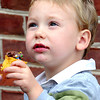 Tobias Sizemore, 3, of Lewisburg enjoys a cupcake from B Sweet during the Taste of our Town festival in Lewisburg on Saturday. F. Brian Ferguson/The Register-Herald