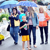 Morning rain did not dampen the spirits of those attending the Taste of our Town festival in Lewisburg on Saturday. F. Brian Ferguson/The Register-Herald