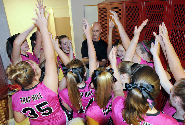 The Trap Hill Middle School Volleyball team looked pretty in pink, in honor of Breast Cancer awareness, as they gathered moments before their Thursday match.  F. Brian Ferguson/The Register-Herald