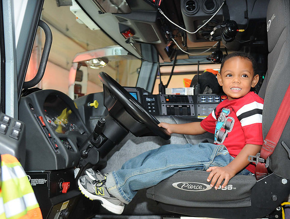 Jacob Mattman, sits in a fire truck at Beckley Fire Station No. 1 on Third Ave. Beckley Fire Department entertained kids from the Raleigh County Head Start with a tour of the Station for Fire Prevention Week. <br /> Rick Barbero/The Register-Herald