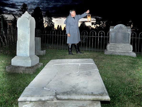 John Luckton's looks over the graves at the Wildwood Cemetery  F. Brian Ferguson/The Register-Herald