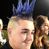 Cole Booze, 10th grader at Greenbrier East, spiked up his hair for game against Lincoln County Friday night in Fairlea.<br /> Rick Barbero/The Register-Herald