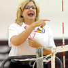 Referee Sharon Hayes makes a call during the Woodrow Wilson Volleyball  match against Oak Hill during Thursday evening action in Beckley.  F. Brian Ferguson/The Register-Herald