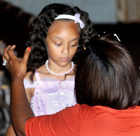 Cyerra Robinson, 8, of Oak Hill, gets some last minute adjustments from her mother Natasha Robinson during the Pretty in Pink Pageant at Woodrow Wilson auditorium on Saturday afternoon. F. Brian Ferguson/The Register-Herald