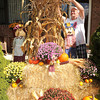 Harry Allen, of Beckley, works on his fall display in his yard off of Old Eccles Road.<br /> Rick Barbero/The Register-Herald