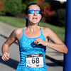 Overall women's winner of the Beckley Half Marathon crosses the finish line on Saturday morning on the campus of UC-Beckley. F. Brian Ferguson/The Register-Herald