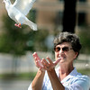 Janet McNeal releases a dove during Saturday's Walk To Remember event at Raleigh General Hospital. F. Brian Ferguson/The Register-Herald