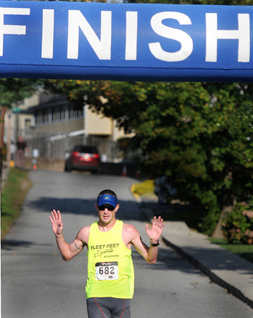 Overall winner of the Beckley Half Marathon, Nick Whited crosses the finish line on Saturday morning on the campus of UC-Beckley. F. Brian Ferguson/The Register-Herald