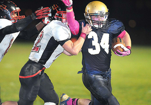 Tyler Hanson, of Shady Spring runs up field for a big gain against Oak Hill defenders  Friday night on H.B. Thomas Field at Shady Spring High School<br /> Rick Barbero/The Register-Herald